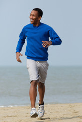 Handsome young man jogging