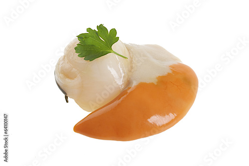 Fresh uncooked scallop  in baking paper isolated on white