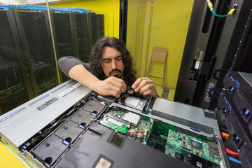 Man working with server in data center