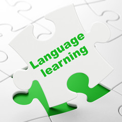 Education concept: Language Learning on puzzle background