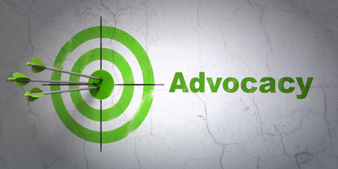 Law concept: target and Advocacy on wall background