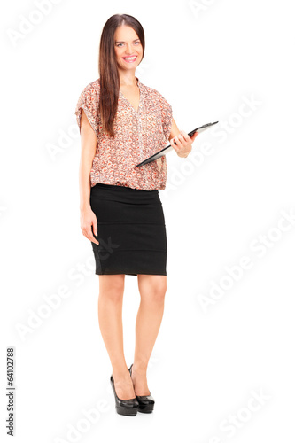 Young woman holding a clipboard