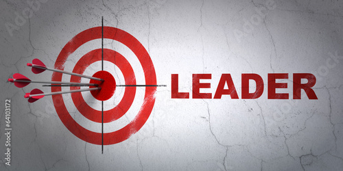 Business concept: target and Leader on wall background