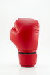 studio shot of a red boxing glove isolated on white background