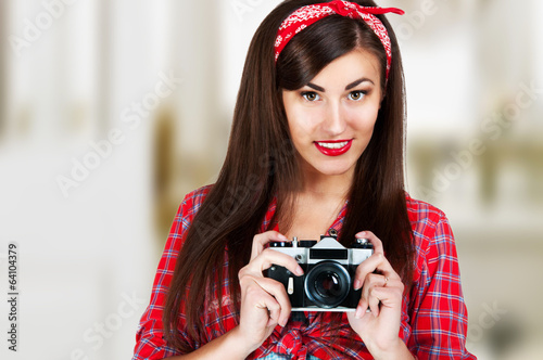 sexy female pinup with the old camera