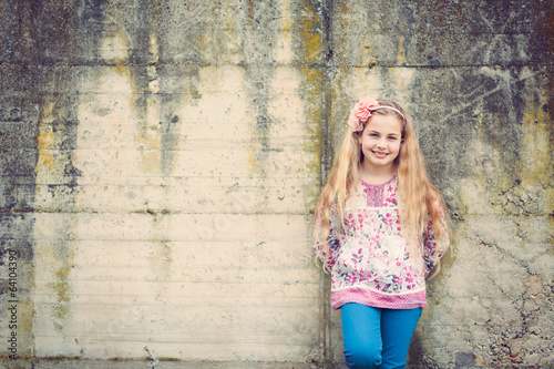 girl  in front of a wall