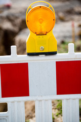 yellow signal lamp on construction site