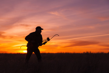 Ready Bowhunter in Sunset