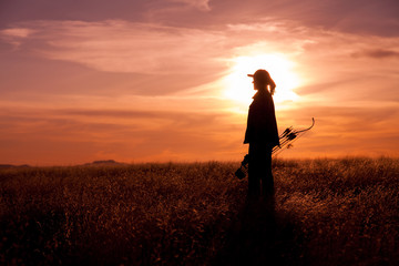 Woman Bowhunter at Sunset