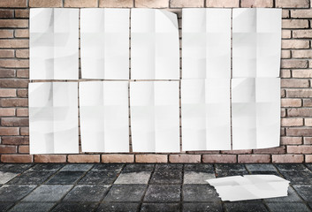 Template- Wall of Crumpled Posters on brick wall & footpath grou