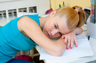 teen girl thinking worried at her study desk
