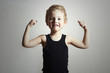 Child. Funny Little Boy.Sport Handsome Boy.hand biceps muscles