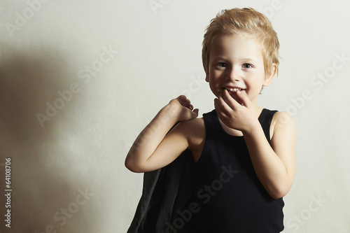 funny little boy.fashion children.handsome smiling kid