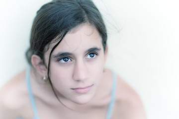 Romantic portrait of a beautiful pensive teenage girl