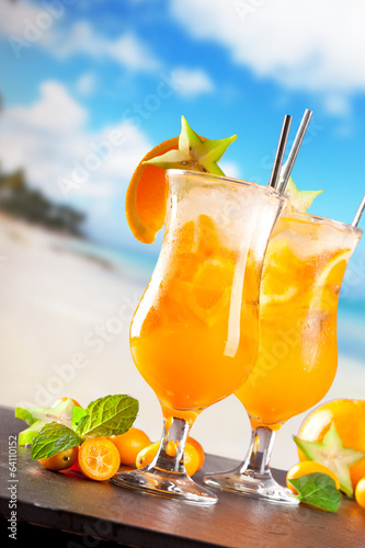 Summer drinks on stone with beach