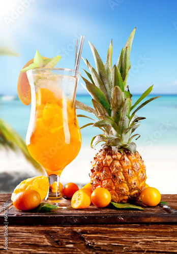 Summer drink on wood with beach