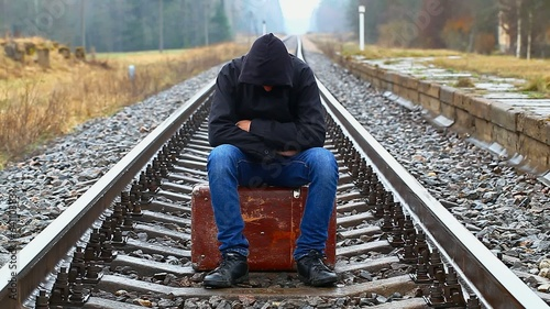 Nervous teenage boy with a suitcase on the railway episode 1