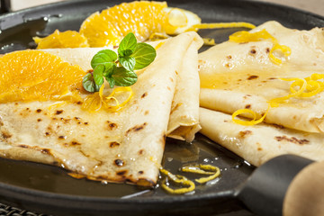 crepes with orange and mint