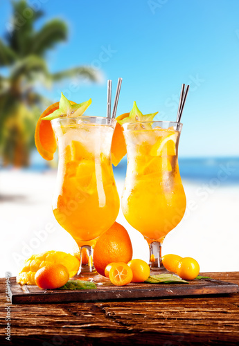 Summer drinks on wood with beach