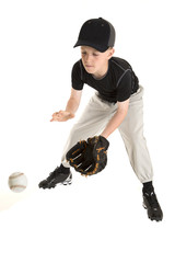 young caucasian baseball player catching a grounder