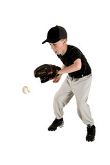 Young caucasian baseball player backhanding a ground ball