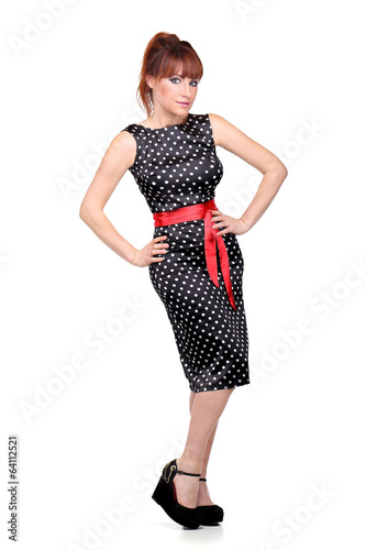 Young woman in dress is posing
