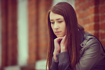 Thoughtful depressed young woman