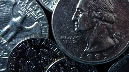 Coins with shimmering scratches close-up