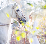 Blonde nymph with the white horse - 64114757