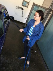 girl washing car at the carwash