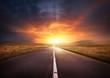 Leinwandbild Motiv Road Leading Into A Sunset
