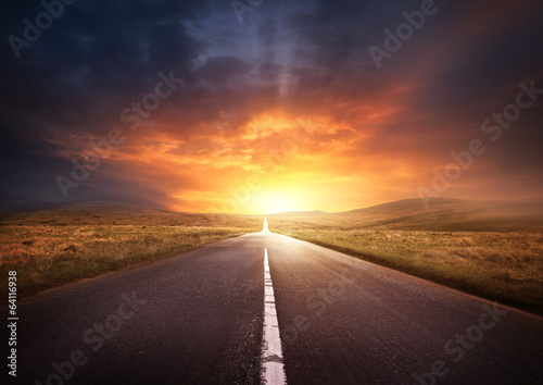 Road Leading Into A Sunset poster