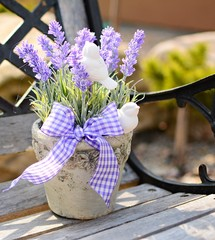 Lavender in the old pot on the bench. Home decoration.
