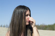 Woman holding her nose (scent, smell, smelling)