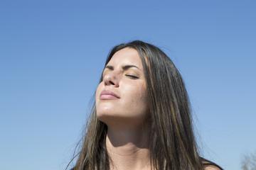 Beautiful woman enjoying sunshine (sun, tan, portrait)