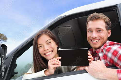 Tablet computer - couple in car showing screen