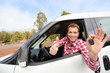 Car driver showing car keys and thumbs up happy