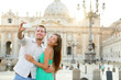Tourists couple by Vatican city in Rome