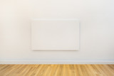 single art canvas in an empty gallery space