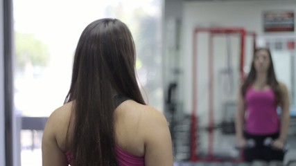 beautiful young woman exercising in gym. Shoulders