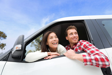 Couple lifestyle in new car looking out window