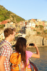 Couple taking photo on smartphone in Cinque Terre