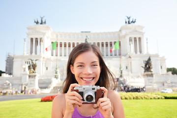 Rome tourist taking photo picture on retro camera