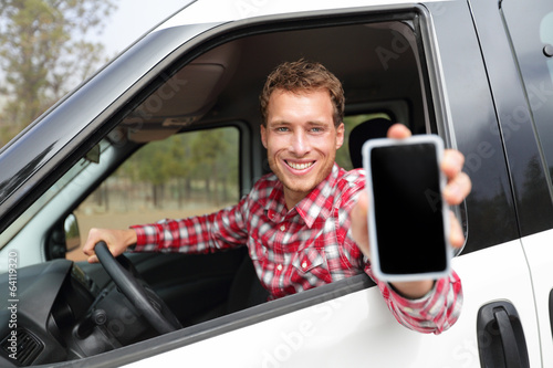 Smartphone man in car driving showing smart phone