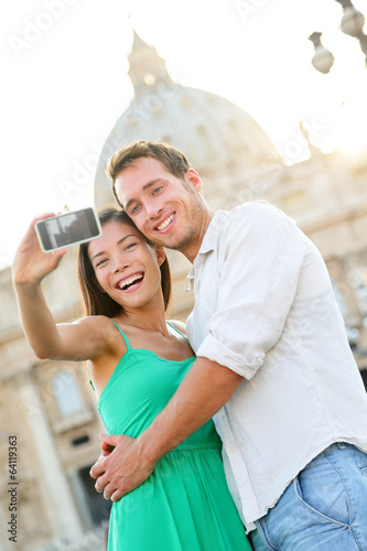 Tourists couple selfie by Vatican city in Rome