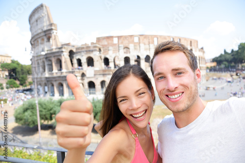 Selfie - Romantic travel couple by Coliseum, Rome