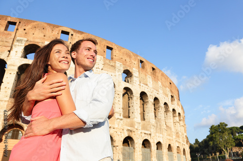 Romantic travel couple in Rome by Coliseum