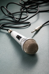 Microphone with a wire on a ridge background