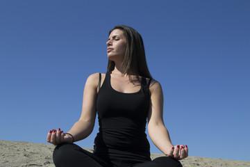 Woman - yoga - beach - meditation - healthy lifestyle