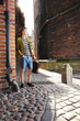 Young man with bag on street, old town Gdansk